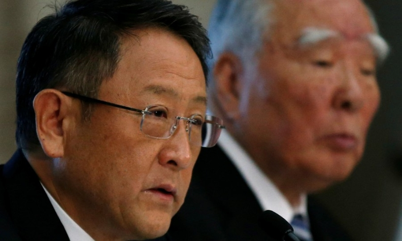 Toyota CEO Akio Toyoda, left, and Suzuki Chairman Osamu Suzuki, are pictured at a joint news conference in 2016.