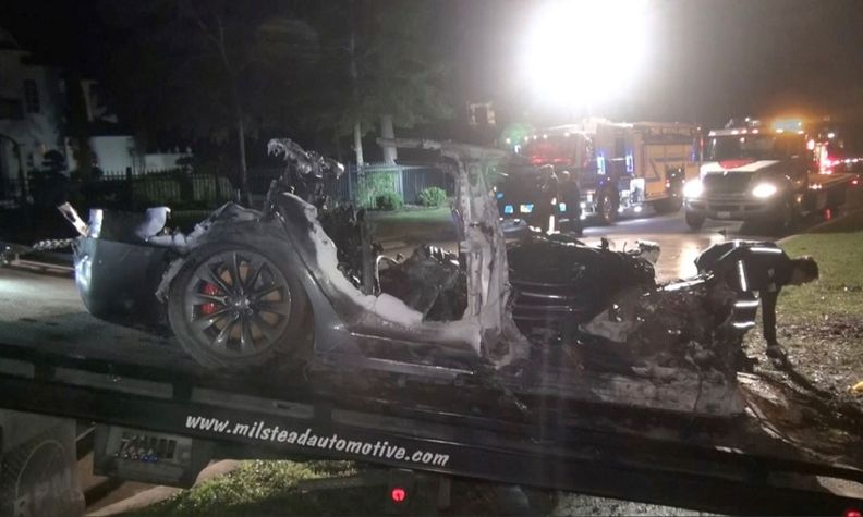 The remains of a Tesla vehicle are seen after it crashed in Texas in this still image from video obtained via social media.