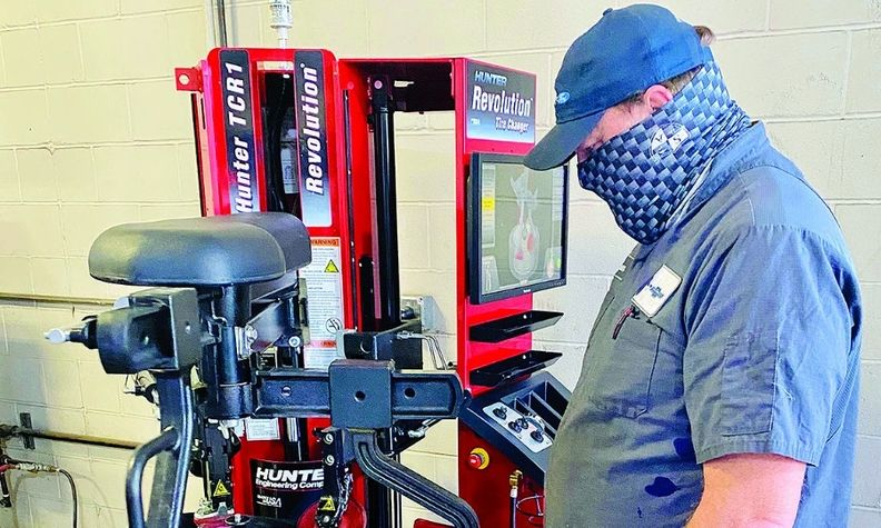 Jason Wells, technician at Yes Chevrolet, operates the dealership's Revolution tire-changing machine.