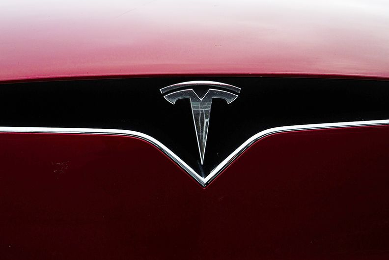 Tesla badge on hood of car