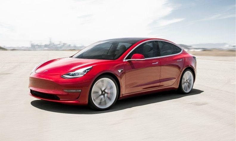 A Tesla Model 3 in red