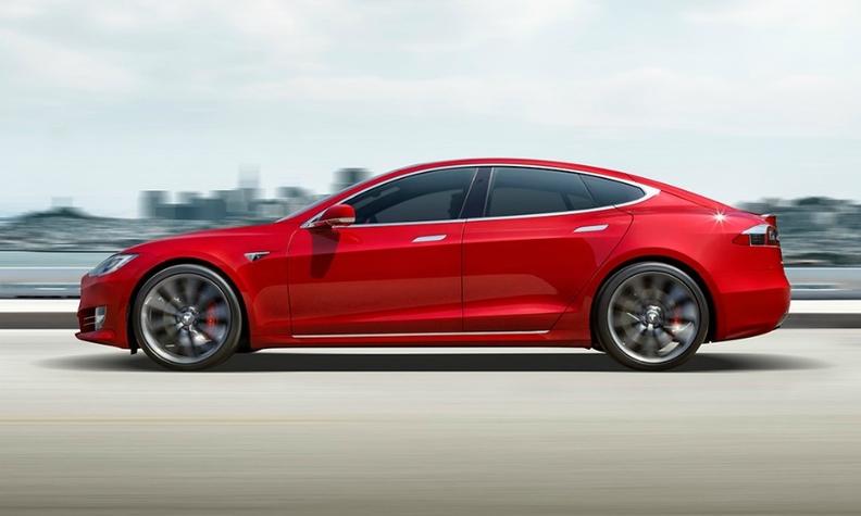 A red Tesla Model S sedan