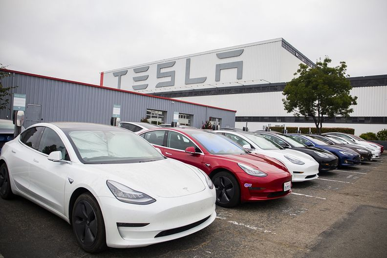 Tesla cars in a lot near its factory
