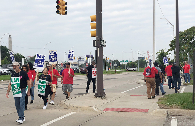 UAW workers picket outside GM's Detroit-Hamtramck assembly plant Monday morning.