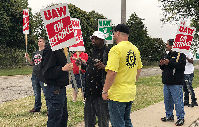 UAW workers outside GM's Lansing Grand River plant said they want to see temporary workers given a more clear path to full-time employment.