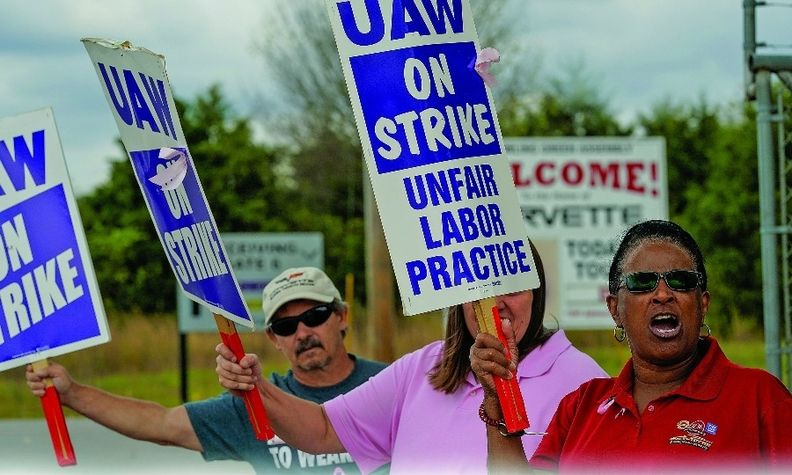 General Motors assembly workers picket outside the Bowling Green plant in Kentucky during the UAW national strike against GM in October.