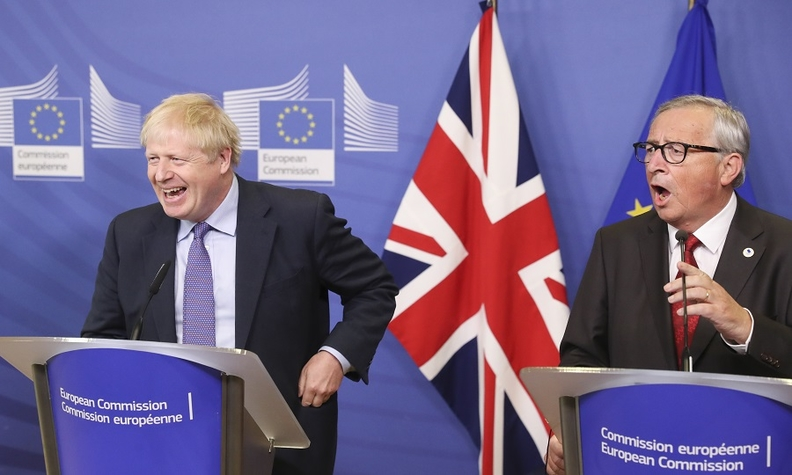 Jean-Claude Juncker, president of the European Commission, right, speaks as British Prime Minister Boris Johnson reacts during a news conference after negotiators reached a Brexit deal.