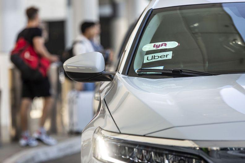 A car with both Uber and Lyft logos