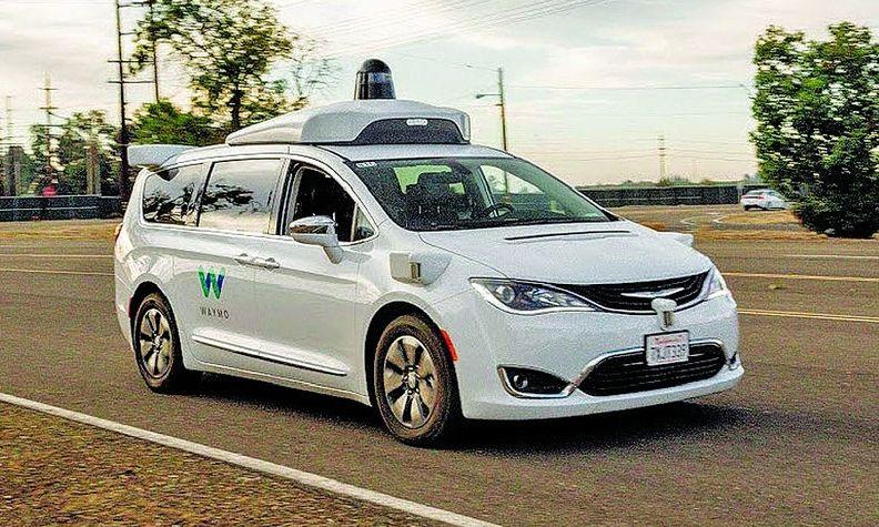 A Waymo self-driving minivan