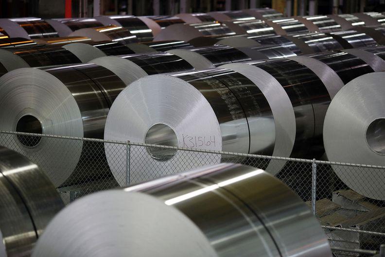 Coils of aluminum await shipping