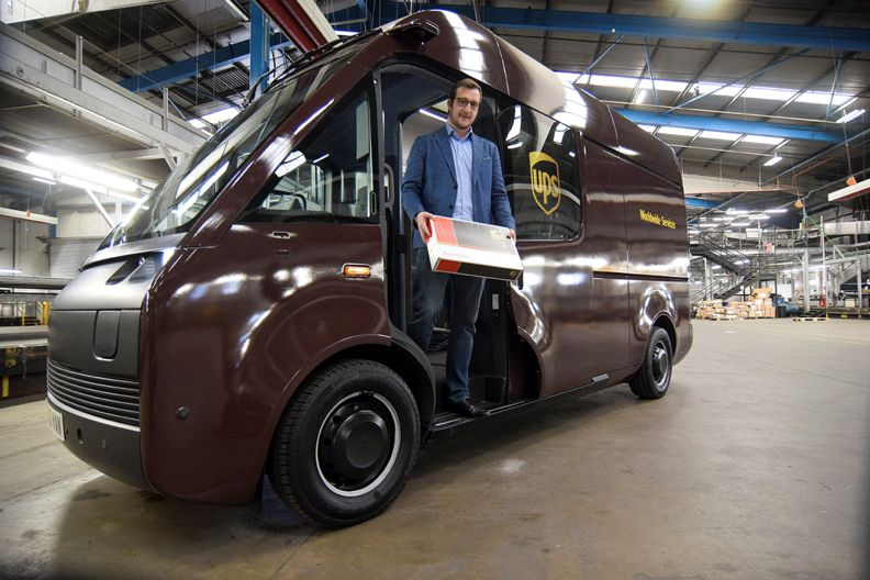 Luke Wake, UPS vice president of maintenance and engineering, stands inside a test model of a fully-electric Arrival van, at a depot in London.