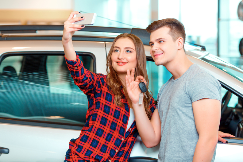 Gen Z car buyers in car dealership
