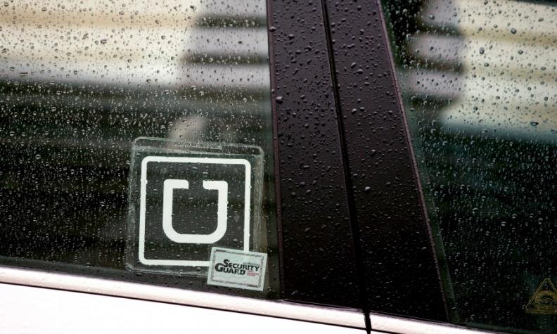 Uber logo on a car window